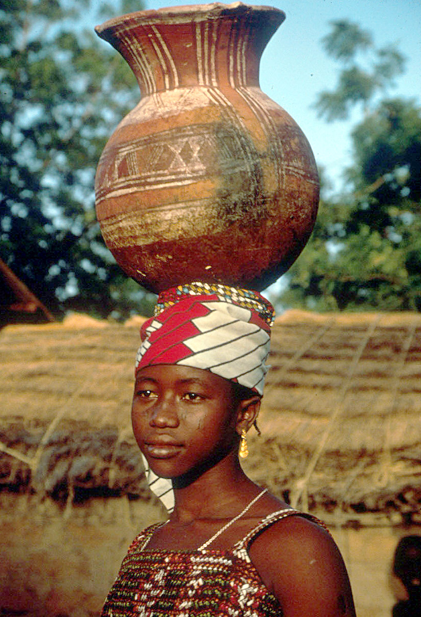 African woman with water on head