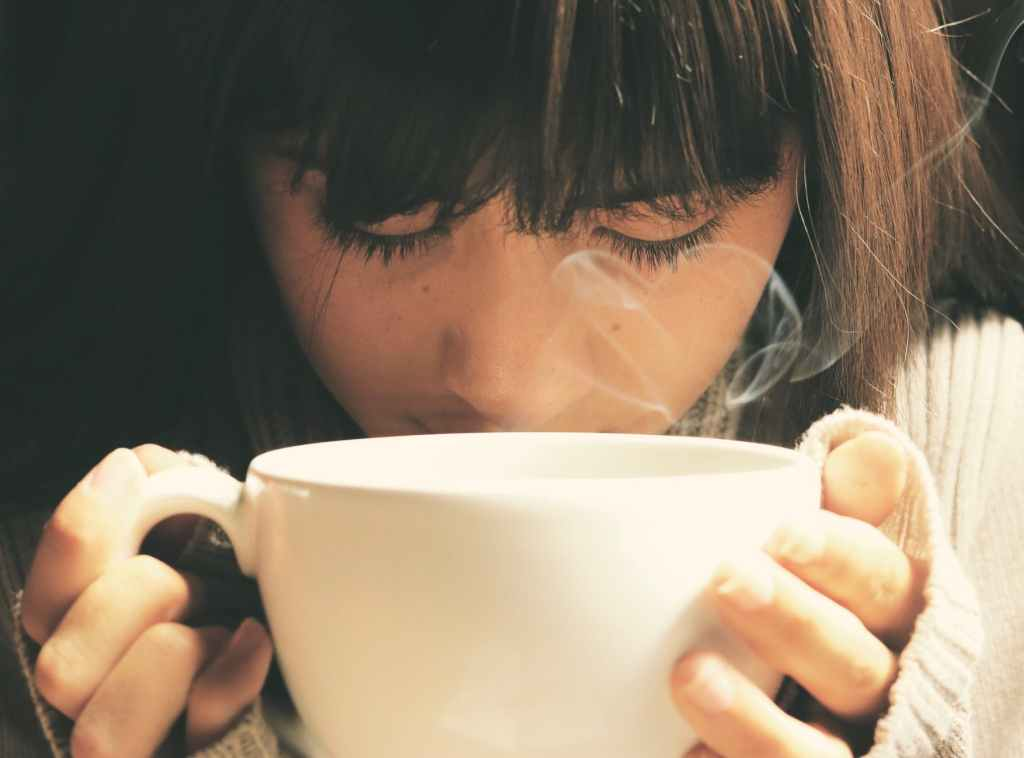 Woman enjoying a cup of tea.